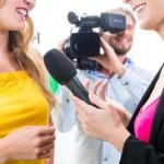 reporter-cameraman-shoot-interview-38573785